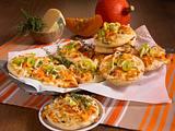 Mini-Pizzen mit Kürbis, Porree und Käse Rezept