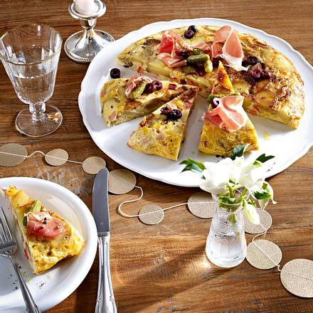 Mit Käse überbackene Tortillastücke Rezept