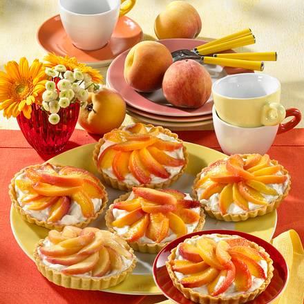Mürbeteig-Torteletts mit Frischkäsecreme und Pfirsichen Rezept