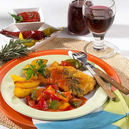 Paprikaschnitzel mit Kartoffelspalten Rezept