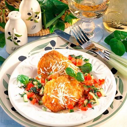 Parmesan-Schnitzel auf Salat Rezept