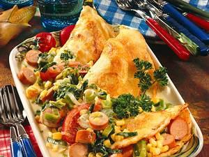 Pfannkuchen mit Gemüse-Wurst-Ragout Rezept