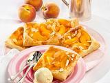 Pfirsich-Blätterteig-Kissen Rezept