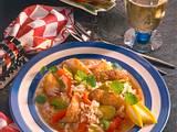 Pikantes Reis-Gemüsegericht mit knusprigen Fischst Rezept