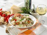 Pilzrisotto mit Rauke, Tomaten und Parmesan Rezept