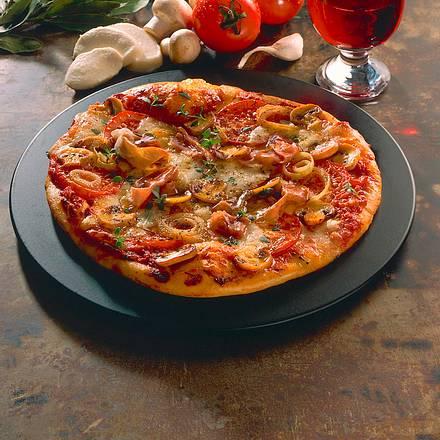 Pizza mit Pilzen und Parmaschinken Rezept