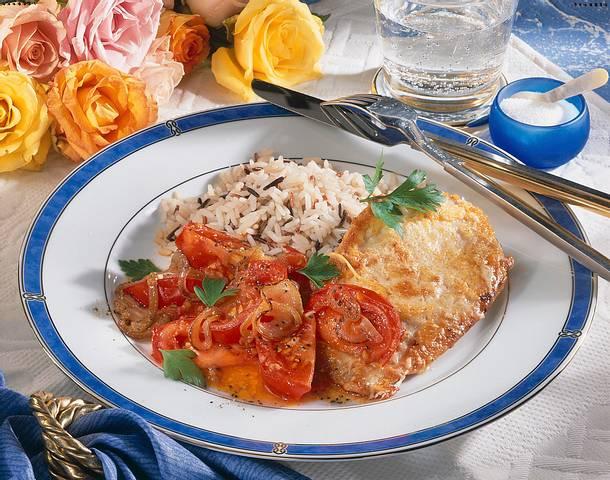 Putenschnitzel im Parmesan-Mantel mit Tomaten und Rezept