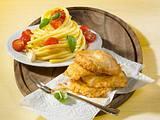 Putenschnitzel in Eihülle mit Makkaroni Rezept