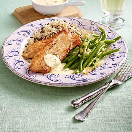 Putenschnitzel mit Reis und Bohnen Rezept
