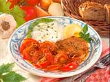 Putensteak mit Tomatengemüse und Gurken-Quark Rezept