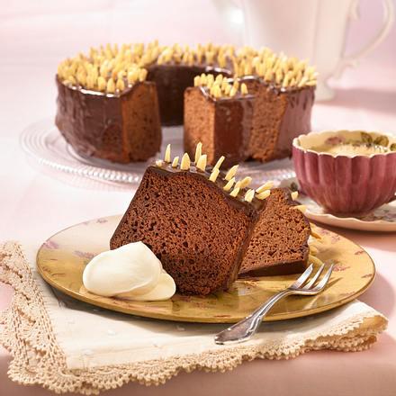 Rehrucken Kuchen Mit Schokoladenglasur Und Mandelstifte Gespickt