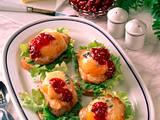 Schlemmerschnitten mit Schweineschnitzel, Pfirsichhälften und Preiselbeeren Rezept