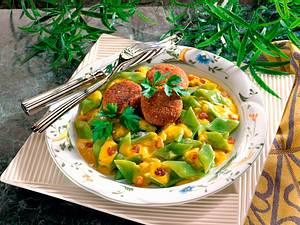 Schneidebohnen in Curry-Joghurtsoße mit Rosinen Rezept