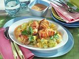 Schnitzelröllchen auf Kartoffel-Gurkengemüse Rezept