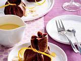 Schoko-Crêpes mit Schokocreme, Orangenschale und Mandelblättchen Rezept