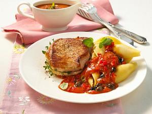 Schweinesteak mit Tomaten-Oliven-Soße Rezept