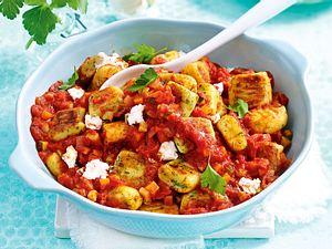 Selbst gemachte Kräutergnocchi in Tomatensoße Rezept