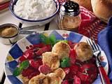 Süße Semmelklöße mit Rhabarberkompott Rezept