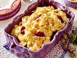 Süßer Grießauflauf mit Kirschen und Mandeln Rezept