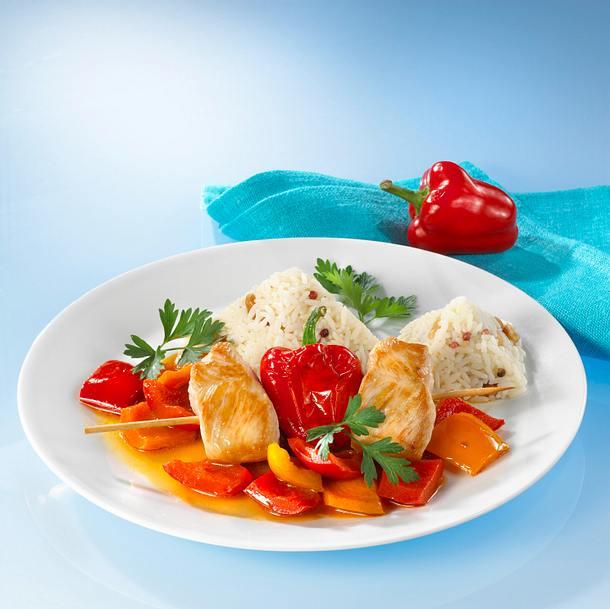 Truthahnbrust mit buntem Paprikagemüse und Reis Rezept