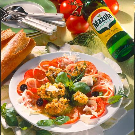 Überbackene Zucchini auf Tomatenbett Rezept