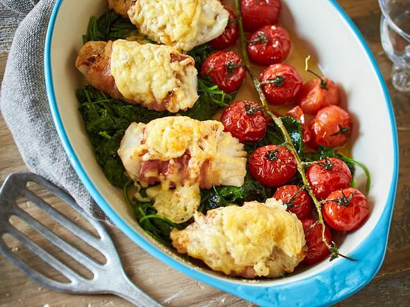 Überbackener Fisch auf Spinat-Tomaten-Bett Rezept