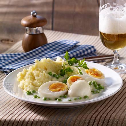 Wachsweiche Eier mit Erbsensoße und Kartoffelpüree Rezept