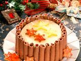 Weihnachtliche Champagnertorte in Schokoladenkeksrollen Rezept